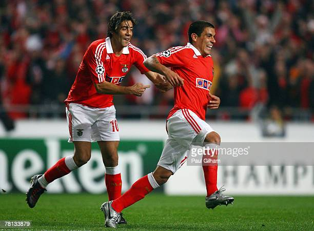 Maxi Pereira of Benfica celebrates with Rui Costa after scoring the first goal for Benfica during the UEFA Champions League Group D match between...