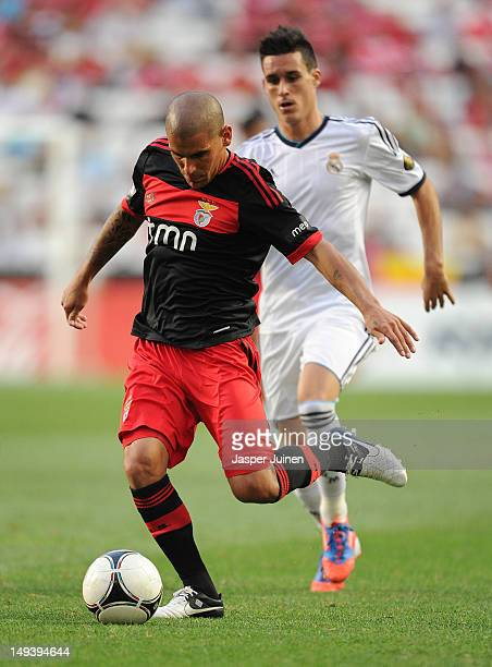 Maxi Pereira of Benfica controls the ball backdropped by Jose Maria Callejon of Real Madrid during the Eusebio Cup match between Benfica and Real...