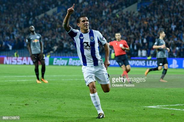 Maxi Pereira of FC Porto celebrates after scores the third goal during the UEFA Champions League group G match between FC Porto and RB Leipzig at...