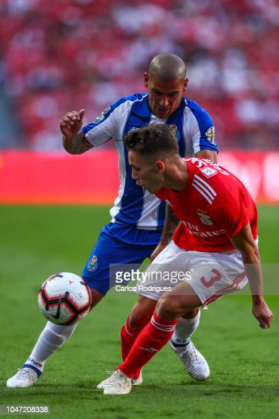 Maxi Pereira of FC Porto vies with Alex Grimaldo of SL Benfica for the ball possession during the Liga NOS round 7 match between SL Benfica and FC...