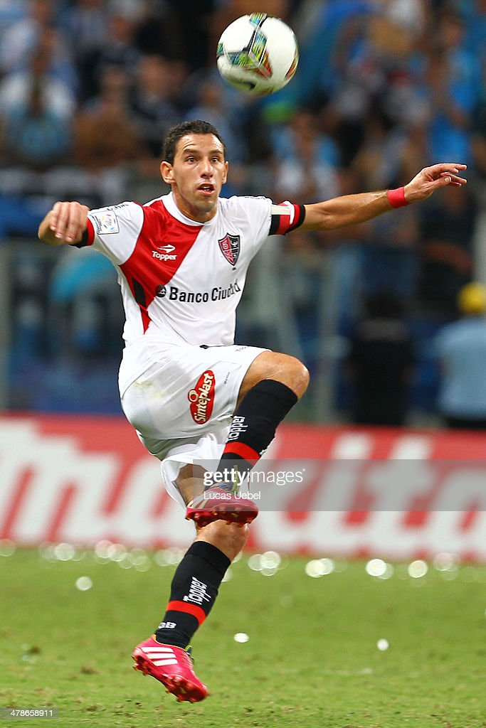 Maxi Rodrigues of Newell's Old Boys runs for the ball during the Copa Bridgestone Libertadores 2014 match between Gremio v Newell's Old Boys (ARG) at Arena do Gremio Stadium on March 13, 2014 in Porto Alegre, Brazil.