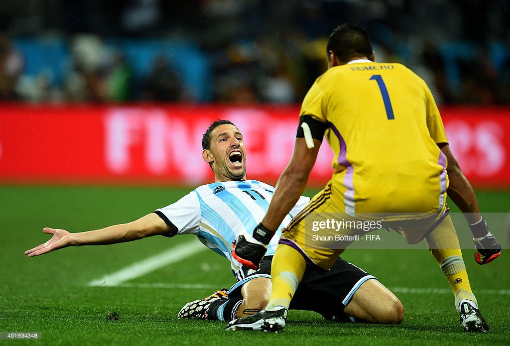 Maxi Rodriguez (L) of Argentina celebrates with Sergio Romero after scoring a penalty to win in the penalty shootout during the 2014 FIFA World Cup Brazil Semi Final match between Netherlands and Argentina at Arena de Sao Paulo on July 9, 2014 in Sao Paulo, Brazil.