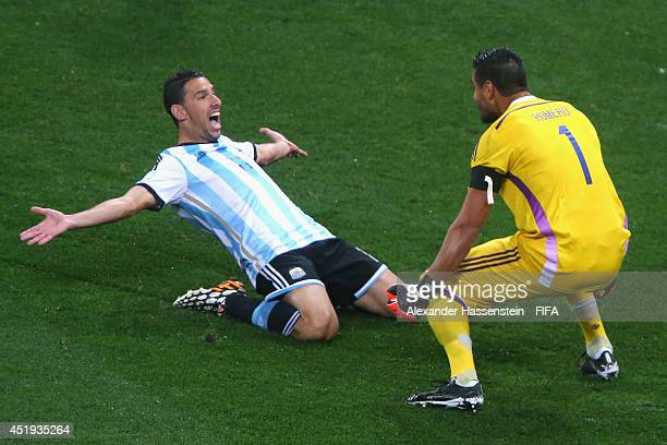 Maxi Rodriguez of Argentina celebrates with Sergio Romero after scoring a penalty to win in the penalty shootout during the 2014 FIFA World Cup...