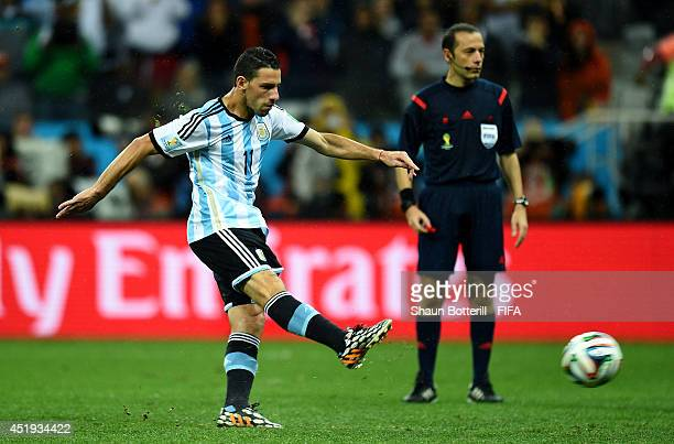 Maxi Rodriguez of Argentina scores in the penalty shootout to win the 2014 FIFA World Cup Brazil Semi Final match between Netherlands and Argentina...