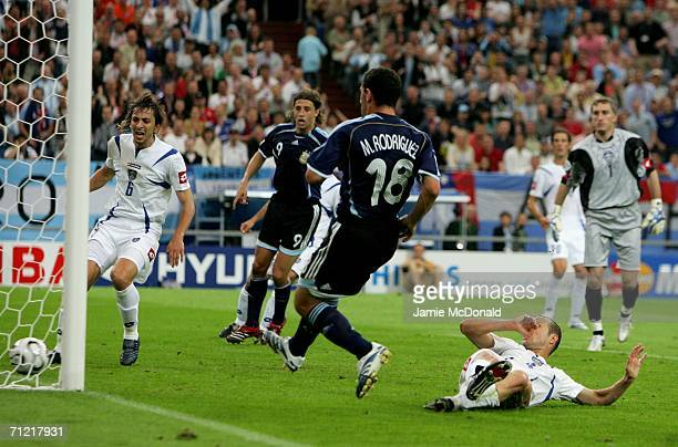 Maxi Rodriguez of Argentina scores the third goal during the FIFA World Cup Germany 2006 Group C match between Argentina and Serbia Montenegro at the...