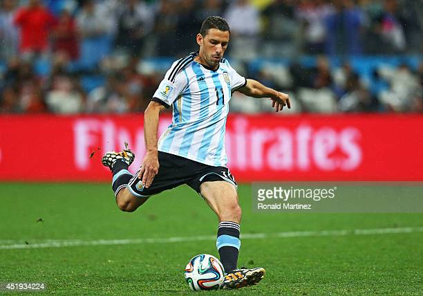 Maxi Rodriguez of Argentina shoots and scores his penalty kick in a shootout to defeat the Netherlands during the 2014 FIFA World Cup Brazil Semi...