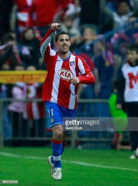 Maxi Rodriguez of Atletico Madrid celebrates after scoring his team's second goal during the La Liga match between Atletico Madrid and Barcelona at...
