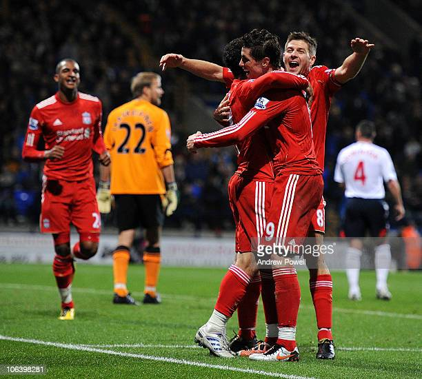 Maxi Rodriguez of Liverpool celebrates after scoring a goal with his teamates during the Barclay Premier League match between Bolton Wanderers and...