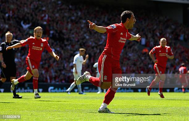 Maxi Rodriguez of Liverpool celebrates after scoring the first goal during the Barclays Premier League match between Liverpool and Newcastle United...