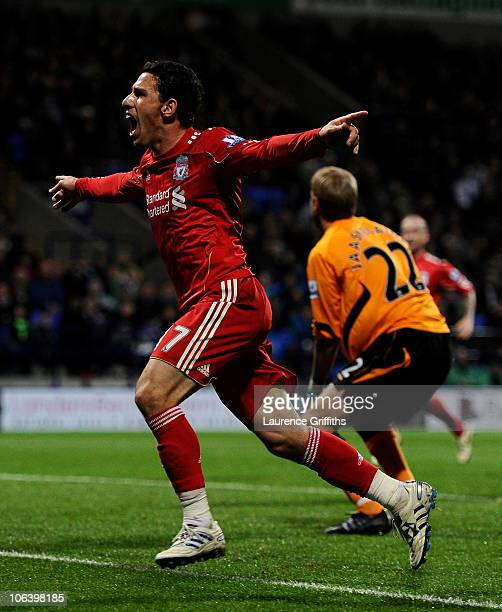 Maxi Rodriguez of Liverpool celebrates scoring the winning goal during the Barclays Premier League match between Bolton Wanderers and Liverpool at...