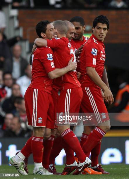 Maxi Rodriguez of Liverpool celebrates the opening goal during the Barclays Premier League match between Fulham and Liverpool at Craven Cottage on...