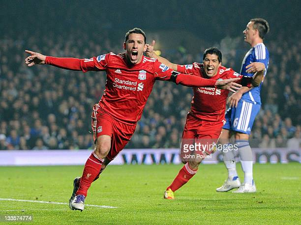 Maxi Rodriguez of Liverpool celebrates with Luis Suarez after scoring the opening goal during the Barclays Premier League match between Chelsea and...