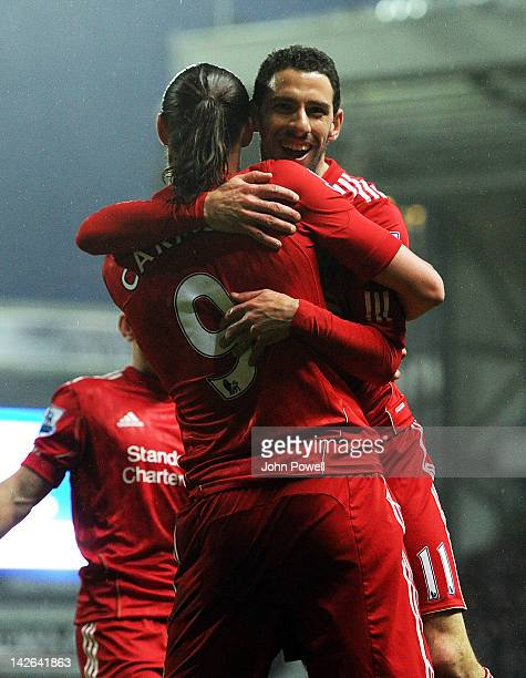 Maxi Rodriguez of Liverpool celebrates with teammate Andy Carroll after scoring his team's second goal during the Barclays Premier League match...