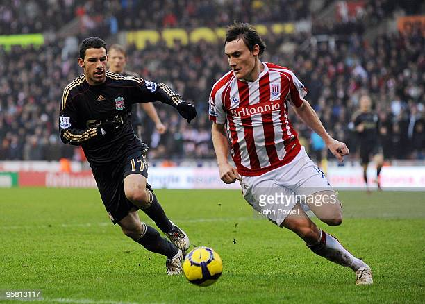 Maxi Rodriguez of Liverpool competes with Dean Whitehead of Stoke during the Barclays Premier League match between Stoke City and Liverpool at...