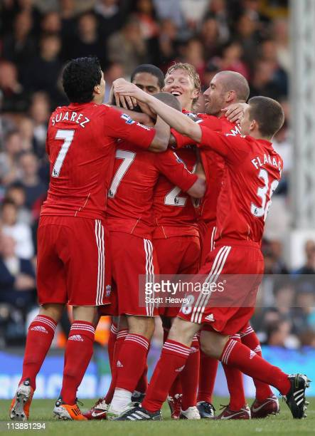 Maxi Rodriguez of Liverpool is mobbed by his team mates after scoring the second goal during the Barclays Premier League match between Fulham and...