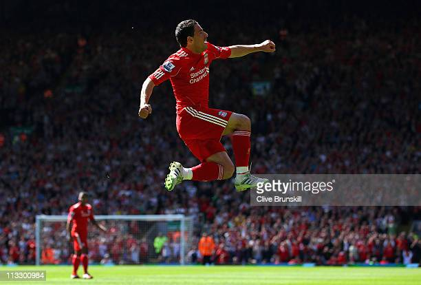Maxi Rodriguez of Liverpool leaps into the air to celebrate after scoring the first goal during the Barclays Premier League match between Liverpool...