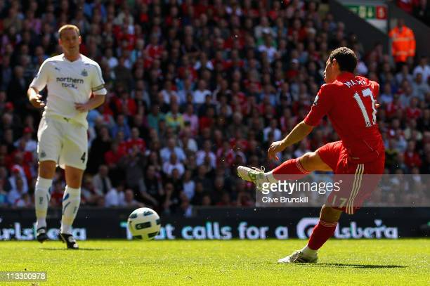 Maxi Rodriguez of Liverpool scores the first goal during the Barclays Premier League match between Liverpool and Newcastle United at Anfield on May...