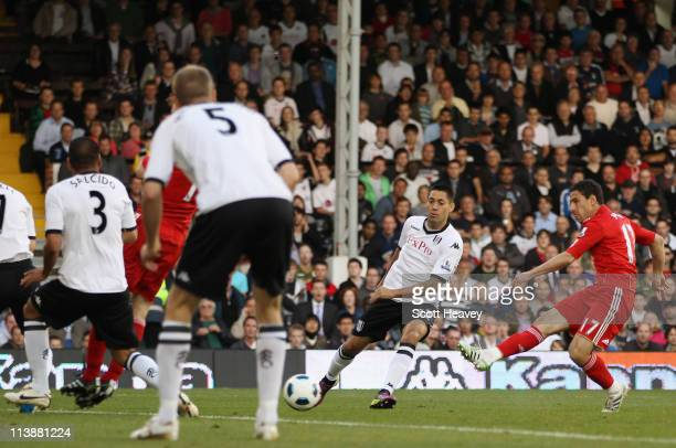 Maxi Rodriguez of Liverpool scores the opening goal during the Barclays Premier League match between Fulham and Liverpool at Craven Cottage on May 9,...