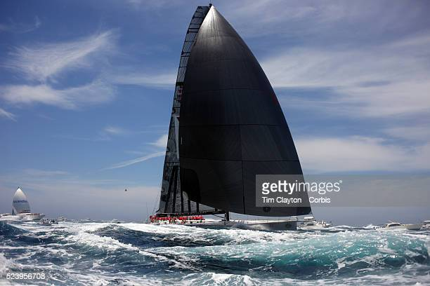Maxi Wild Oats XI navigates through the flotilla of spectator craft and media helicopters as the fleet heads down the Eastern coastline of Australia...