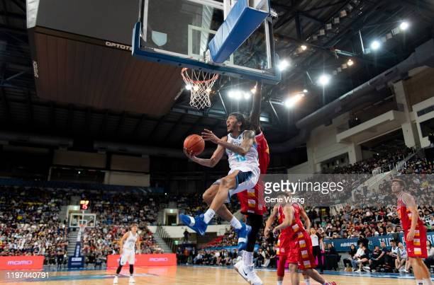 Maxie Esho of Taipei Fubon Braves attack the basket during the ASEAN Basketball league match between Taipei Fubon Braves and Singapore Slingers at...