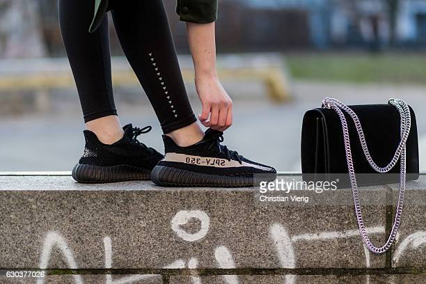 Maxilie Mlinarskij is wearing a black Agneel bag black HM leggings black Adidas yeezy boost 350 vs on December 21 2016 in Berlin Germany
