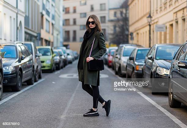 Maxilie Mlinarskij is wearing a green Dawid Tomaszewski wool coat a black Agneel bag black HM leggings Gentle Monster sunglasses black Adidas yeezy...