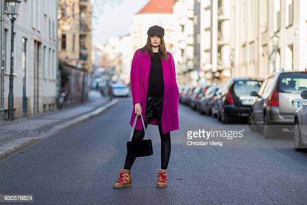 Maxilie Mlinarskij is wearing a pink Guido Maria Kretschmer wool coat a black HM flat cap black tights Isabel Marant Ãtoile fed winter boots with...