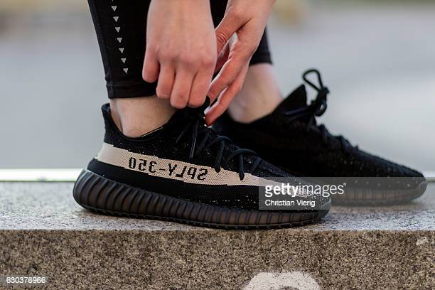 Maxilie Mlinarskij is wearing black HM leggings black Adidas yeezy boost 350 vs on December 21 2016 in Berlin Germany