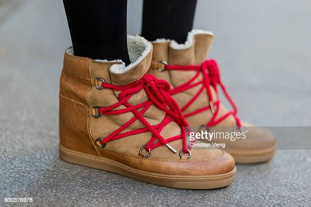 Maxilie Mlinarskij is wearing Isabel Marant Ãtoile fed winter boots with calfskin and wool and red shoe lace on December 21 2016 in Berlin Germany