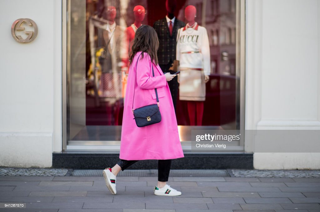 maxilie mlinarskij is window shopping in front of a gucci store