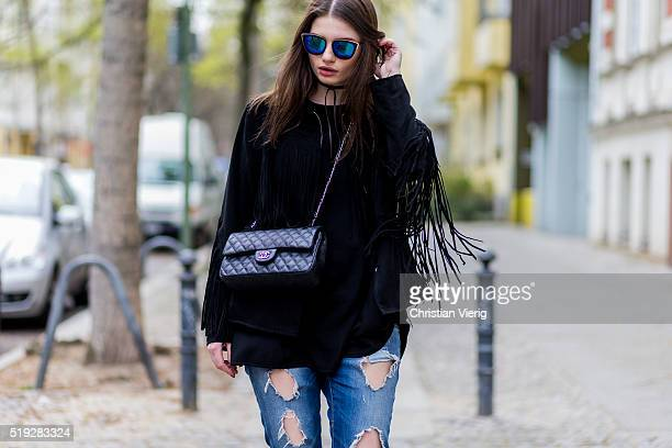 Maxilie Mlinarskij seen wearing a black fringe jacket from HM blue ripped jeans from Zara Zero Vintage sunglasses and a black Chanel bag on April 5...