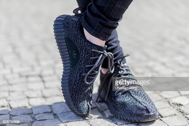 Maxilie Mlinarskij wearing a black Acne denim jeans black Adidas Yeezy boost sneaker on April 24 2016 in Berlin Germany