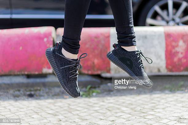 Maxilie Mlinarskij wearing a black Acne denim jeans black Adidas Yeezy boost sneaker on April 24 2016 in Berlin Germany