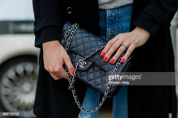 Maxilie Mlinarskij wearing a black Chanel bag and red nail polish on August 15 2016 in Berlin Germany