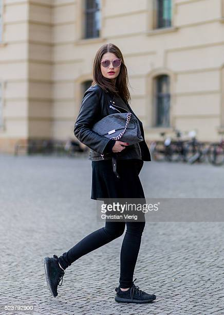 Maxilie Mlinarskij wearing a black leather jacket from Proenza Schouler a black Zara tshirt black Acne denim jeans a grey Stella McCartney bag Dior...