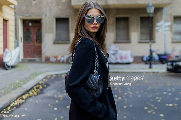 Maxilie Mlinarskij wearing a black vintage coat a black Chanel bag a grey shirt from Alexander Wang sunglasses from Forever 21 on August 15 2016 in...