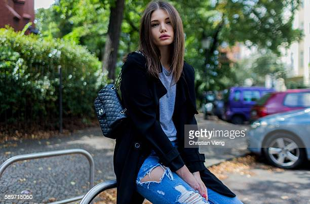 Maxilie Mlinarskij wearing a blue ripped denim jeans from Zara a black vintage coat a black Chanel bag a grey shirt from Alexander Wang on August 15...