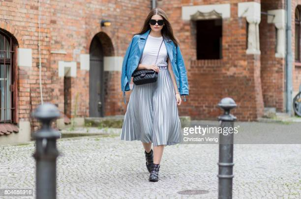 Maxilie Mlinarskij wearing a silver midi skirt Mango a white tshirt HM a blue leather jacket Be Edgy black Topshop boots black Chanel bag Zero...