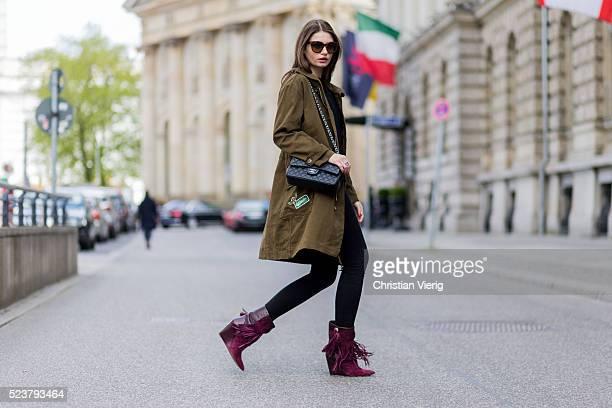 Maxilie Mlinarskij wearing an olive green military parka from Zara black Acne denim jeans a black jumper Celine sunglasses black Chanel bag purple...