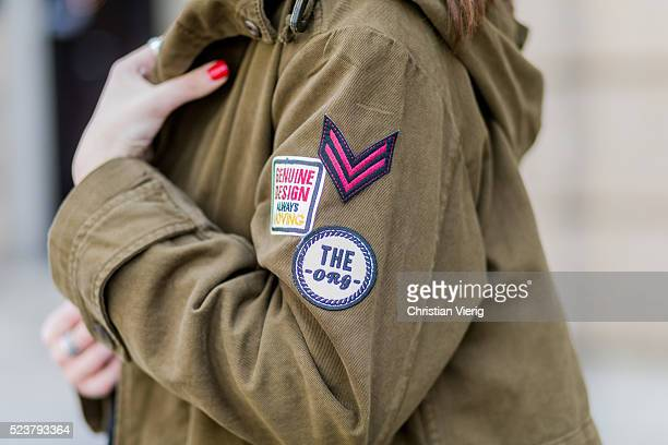 Maxilie Mlinarskij wearing an olive green military parka witch patches from Zara on April 24 2016 in Berlin Germany
