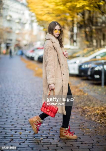Maxilie Mlinarskij wearing beige HM teddy coat red Chanel bag Isabel Marant boots black skinny denim jeans white sweater Fiorucci on November 13 2017...