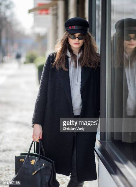Maxilie Mlinarskij wearing black Helmut Lang wool coat Alt Swim hat Gigi Hadid for Vogue Eyewear sunglasses Zara leather pants The Seller boots with...