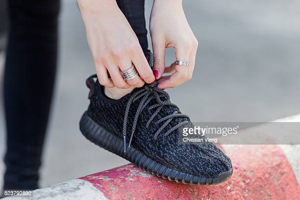 Maxilie Mlinarskij wearing red nail polish and black Adidas Yeezy boost sneaker on April 24 2016 in Berlin Germany