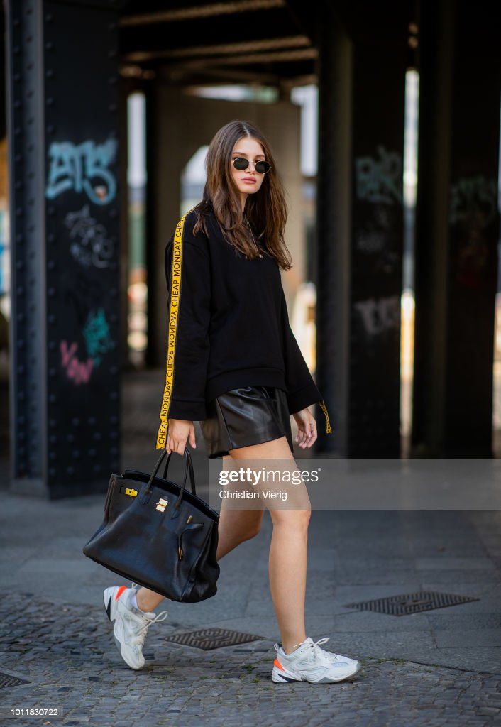 Maxilie Mlinarskij wearing sweater Cheap Monday, Zara shorts, Nike M2K Tekno sneakers, Hermes bag, APC Monaco & Adimas jewelery, Ray Ban sunglasses on August 5, 2018 in Berlin, Germany.