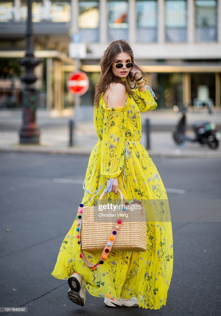 Maxilie Mlinarskij wearing yellow maxi dress Self Portrait, Nannacay bag, Nike M2K Tekno sneakers, Ray Ban sunglasses on August 5, 2018 in Berlin, Germany.