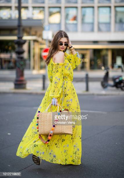 Maxilie Mlinarskij wearing yellow maxi dress Self Portrait Nannacay bag Nike M2K Tekno sneakers Ray Ban sunglasses on August 5 2018 in Berlin Germany