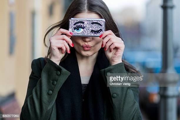Maxilie Mlinarskij with red nail polish and with a Chiara Ferragni The Blonde Salad flirting iphone cover on December 21 2016 in Berlin Germany