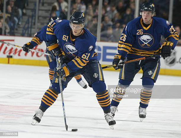 Maxim Afingenov of the Buffalo Sabres skates ahead of teammate Thomas Vanek during his first game back from injury against the Pittsburgh Penguins on...