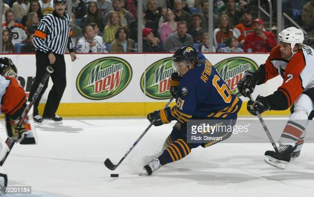 Maxim Afinogenov of the Buffalo Sabres moves toward the net as he scores his first, and Buffalo's sixth goal of the game ahead of Derian Hatcher of...