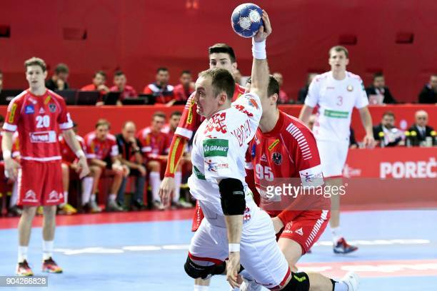 Maxim Babichev of Belarus shoots to score during the preliminary round group B match of the Men's 2018 EHF European Handball Championship between...